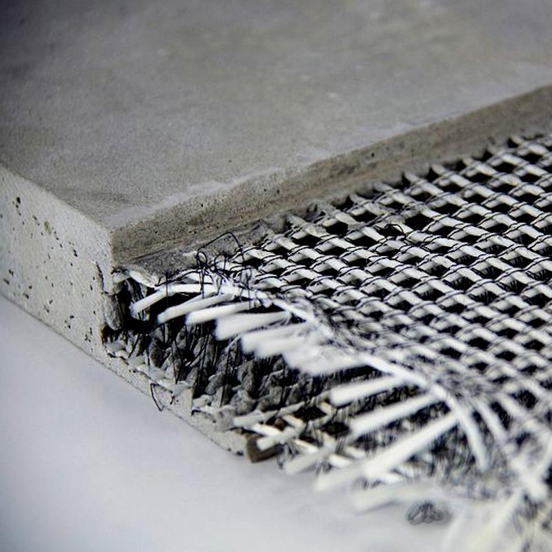 La composizione di un tessuto strutturale a base di cemento
