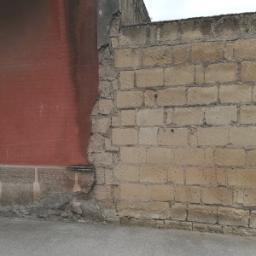 Intonaco degradato su muratura di tufo