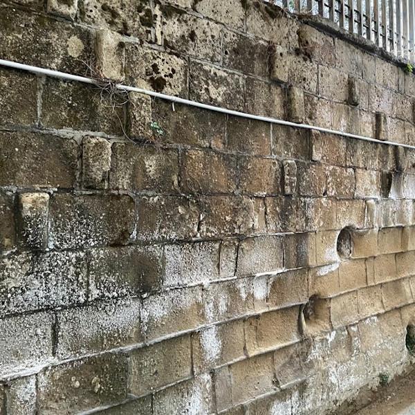 Effects of rising damp on tuff masonry