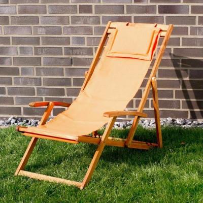 Witt lounge chair in acacia wood, orange - Photo: eBay