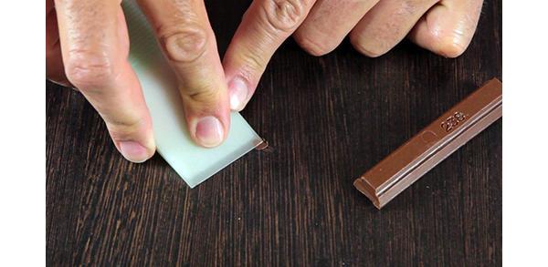 Application of Antichità Belsito wax wood putty in stick