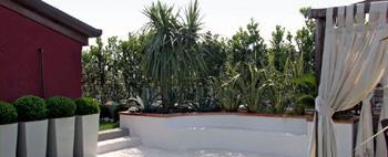 Sandrini Garden Designers: giardino pensile