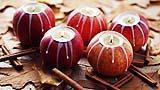 Candele inserite nella frutta