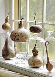 zucche ornamentali in vaso di vetro